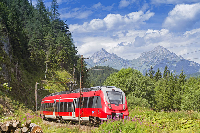 austria-train-through-mountain-landscape