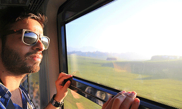 guy-looking-out-of-train-window-spain