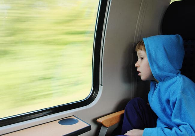 Interrail family discounts - boy looking out of the train window