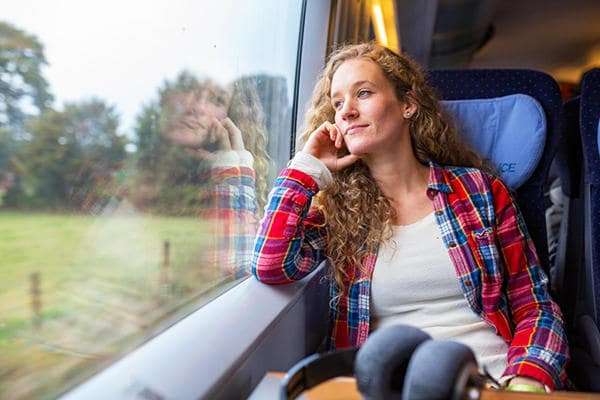 young_woman_looking_out_of_a_train_window